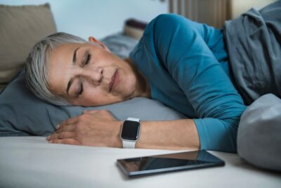 older woman measuring sleep with watch